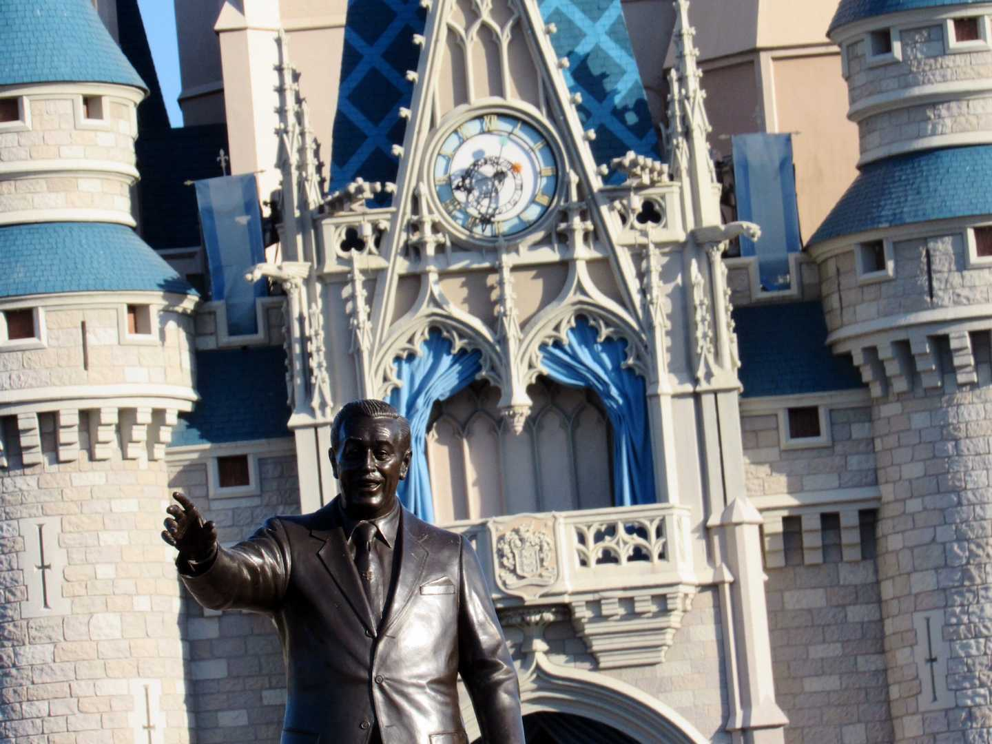 The iconic Walt Disney statue is pictured with Cinderella's Castle in Magic Kingdom.