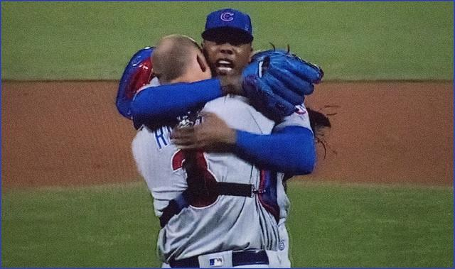 Catcher+David+Ross+and+closer+Aroldis+Chapman+hug+in+relief+after+the+Cubs+win+the+NLCS