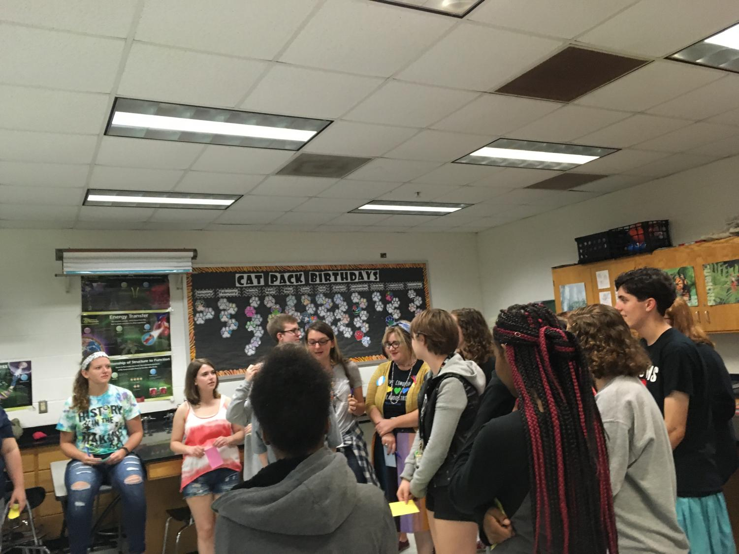 "New and returning members of PRIDE Club participate in a ""getting to know you"" activity at their first meeting on August 27th, 2018. Photo by Ariana South"
