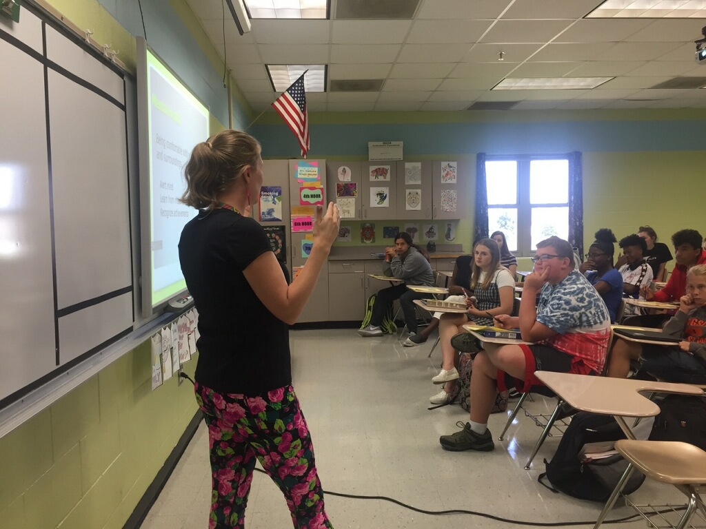 Mrs. Sharer-Barbee teaches her health class about the importance of mental health in high school. 