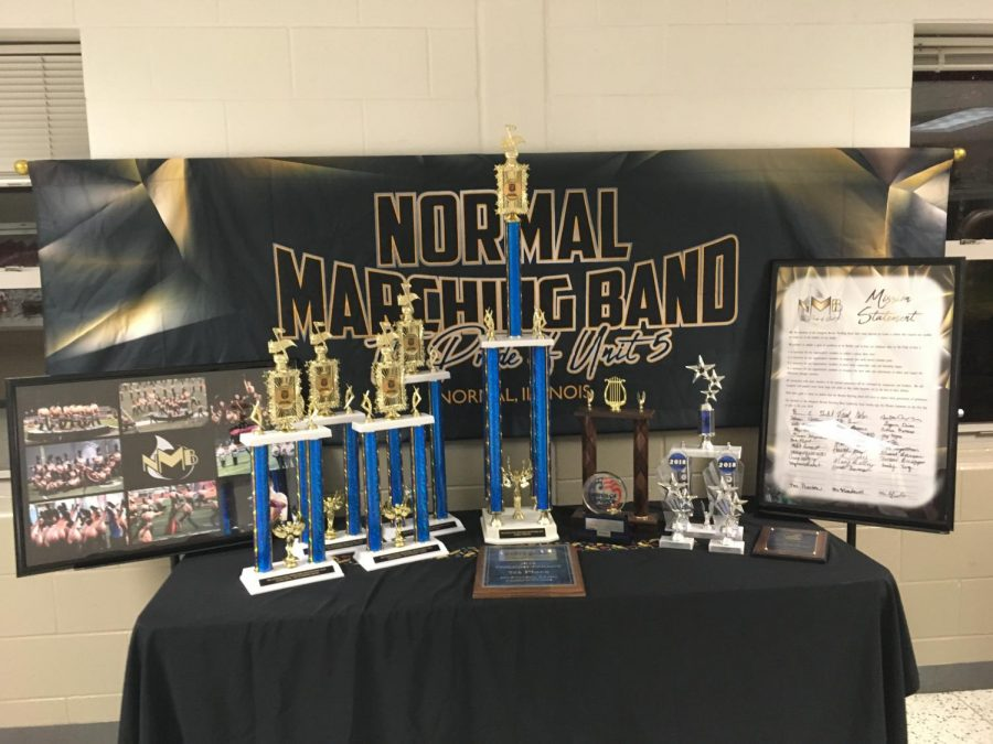 +The+NMB%E2%80%99s+banner%2C+trophies%2C+photos+and+mission+statement+on+display+at+the+Unit+5+Music+Parents+Spaghetti+Supper+at+West.+Photo+by+Ariana+South.